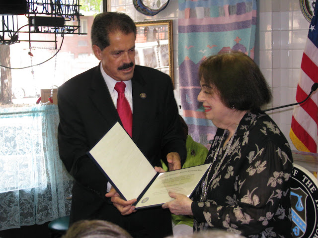 Congressman Jos&eacute; Serrano, handing Bethex FCU President &amp; CEO Joy Cousminer with a $750,000 award from the U.S. Treasury Department's CDFI Fund.