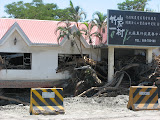 damaged building in Taimali