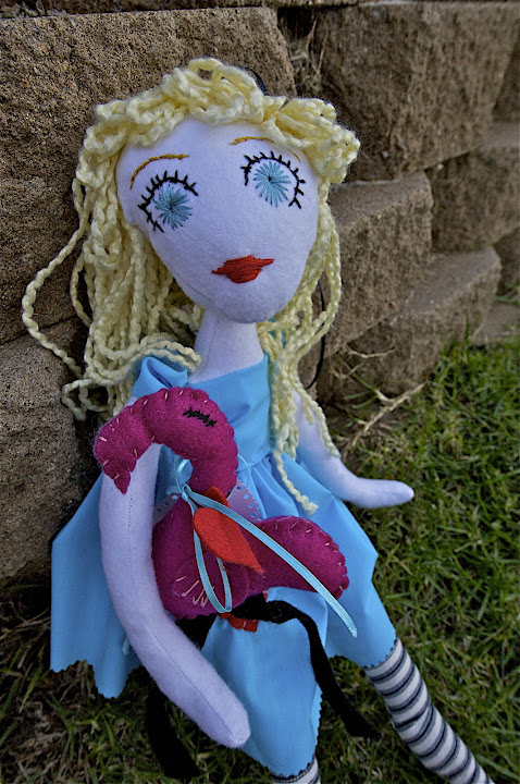 Alice Plays Croquet, a one-of-a-kind soft doll by Cimmerii Mills. Soft yarn hair, embroidered face, cotton dress, felt flamingo accessory.
