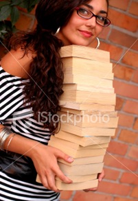 ist2_3974419-student-holding-books