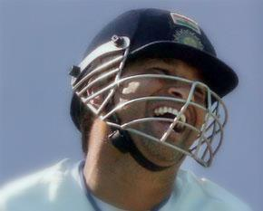Sachin Tendulkar laughing while playing cricket