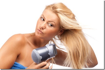 Blonde beauty with hair drier