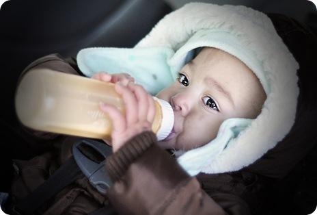 ella with bottle