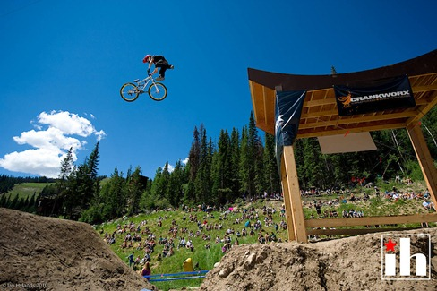 Jack Fogelquist tailwhip during the Crankworx Colorado Slopestyle Final at the Trestle Bike Park in Winterpark Colorado.