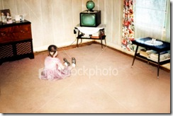ist2_157028-little-girl-watching-first-television-retro-vintage-style