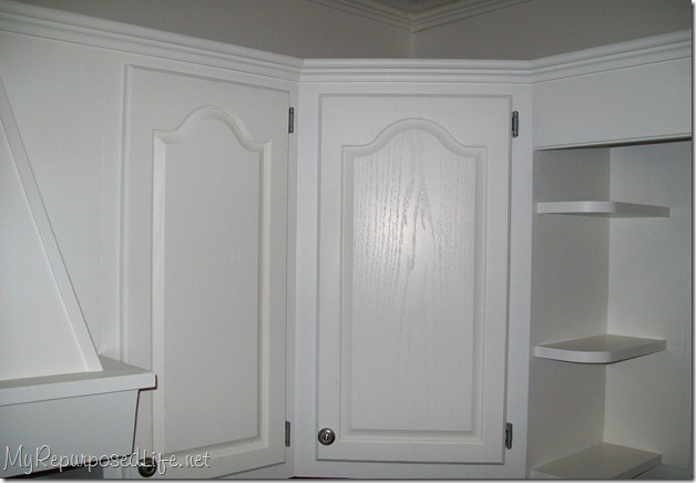 How to paint oak cabinets my repurposed life for Painting wood kitchen cabinets white