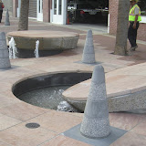 Manhole cover fountains with cones