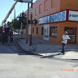 Removing ATT cables and poles after placing cables in underground conduit.