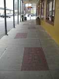 Paver panels added to existing sidewalk by sawing in tool joint. Final product appears as if built at same time.