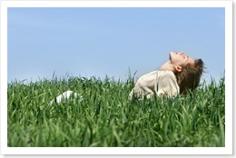 young girl relaxing in green grass