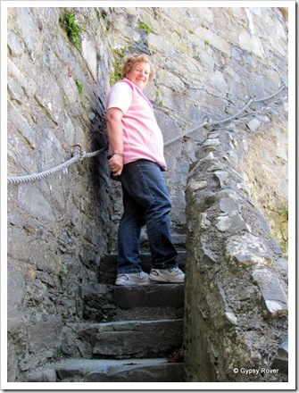 Heading up the narrow stairs to the parapet.