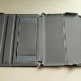 The inside of the case has a soft felt like lining for protection. On the left of the case you can see the hand strap and the 2 indentations which support the iPad at 2 viewing angles