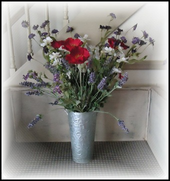 tin with flowers