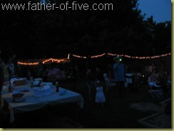 Darkness falls as the party winds down