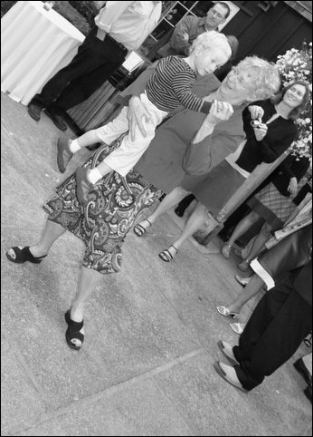 Grandma Sandy and alex dancing at wedding
