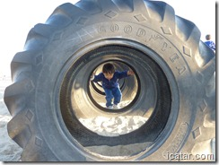 Nathaniel makes his way through the giant tires