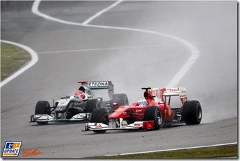 Fernando Alonso (ESP) Ferrari F10 and Michael Schumacher (GER) Mercedes GP MGP W01 battle for position.  Formula One World Championship, Rd 4, Chinese Grand Prix, Race, Shanghai, China, Sunday 18 April 2010.