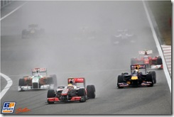 Lewis Hamilton (GBR) McLaren MP4/25 Adrian Sutil (GER) Force India F1 VJM03 and Sebastian Vettel (GER) Red Bull Racing RB6 battle for position. 