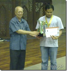 Ian Udani receives trophy from IIUM's Rector, Prof.Syed Arabi