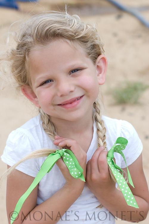 Erika holding braids blog