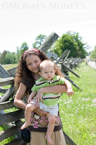 Brianna holding Scott by fence blog