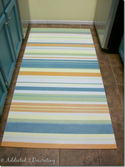 make an easy clean floor cloth from a scrap piece of vinyl flooring