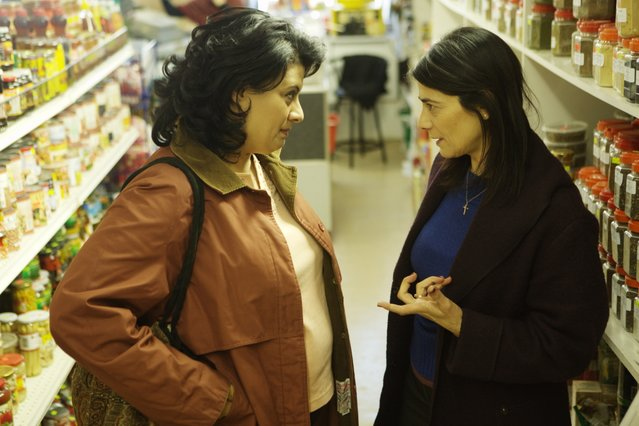 In Amreeka, Palestinian immigrant Muna (Nisreen Faour, left) learns how to negotiate the American Midwest with a little help from her sister (Hiam Abbass).