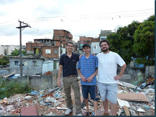On the rubbish heap outside the favela. The government doesn't provide decent services.