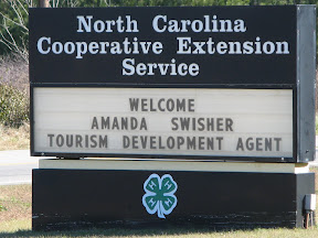 Road sign welcoming Robeson County Tourism Extension Agent
