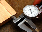 Measuring the dado width with dial calipers