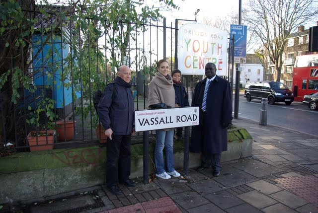 Vassall Labour candidates standing by Vassall Road sign, SW9