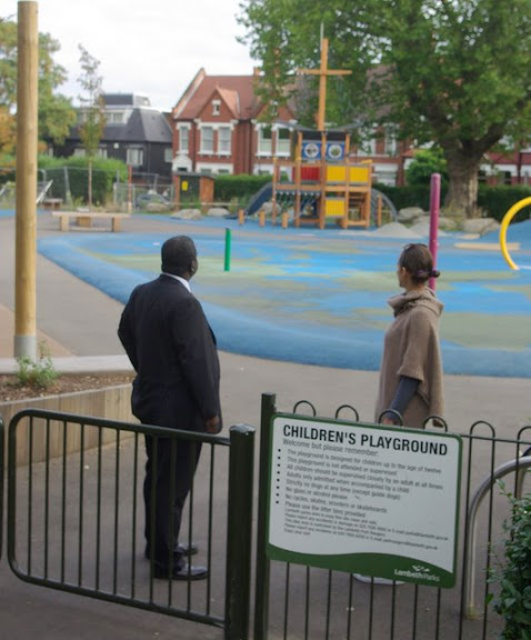 Photo of Vassall Action Team members Kingsley Abrams and Tracy Ritson inspecting Myatts Fields Park children's playground, SE5