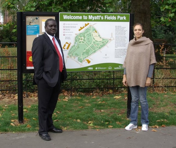 Photo of Kingsley Abrams and Tracy Ritson posing in front of Myatts Fields Park sign, Vassall Ward