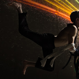 Rainbow Fly by Ian Craig - People Body Parts ( studio, acrobat, dark, swing, rainbow, photography )