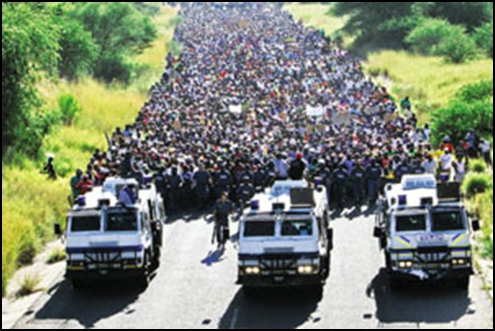 WE will disrupt WC2010 Oukasie protestors outside Brits 5000 people heading to Madibeng municipal offices March92010