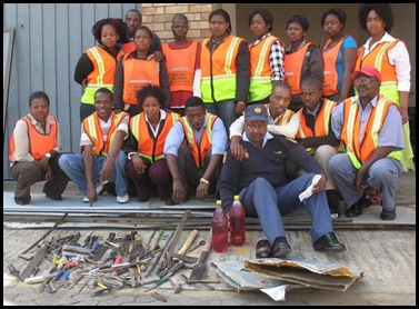 East London citizen-crime fighters and their haul of confiscated weapons sgt Vusisile Slatsha