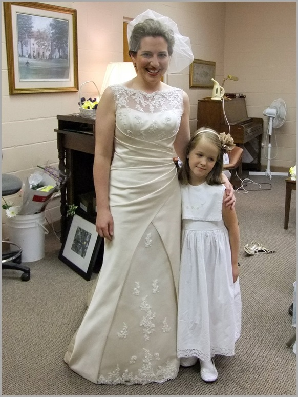 Mary in Her Wedding Dress with Flower Girl Catia