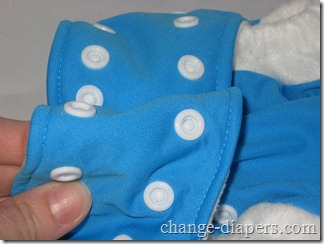 fold other tab & attach to newborn snaps