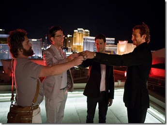 "(L-r) Alan (ZACH GALIFIANAKIS), Stu (ED HELMS), Doug (JUSTIN BARTHA) and Phil (BRADLEY COOPER) raise a toast on the rooftop to commence Doug's bachelor party in Warner Bros. Pictures' and Legendary Pictures' comedy ""The Hangover,"" a Warner Bros. Pictures release.