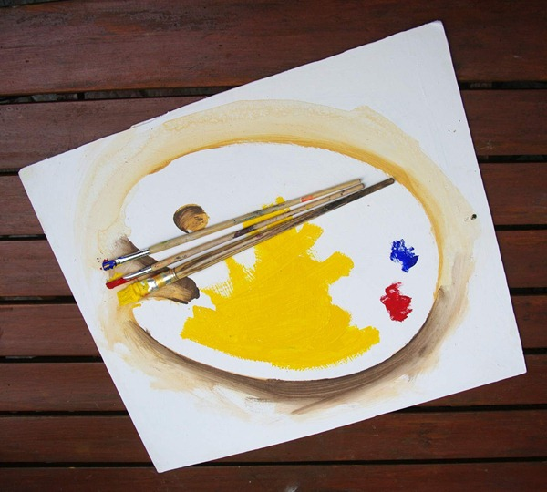 Photo of Painted Palette with Real Brushes