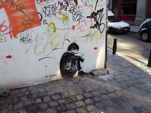 sitting kid by Jef Aérosol