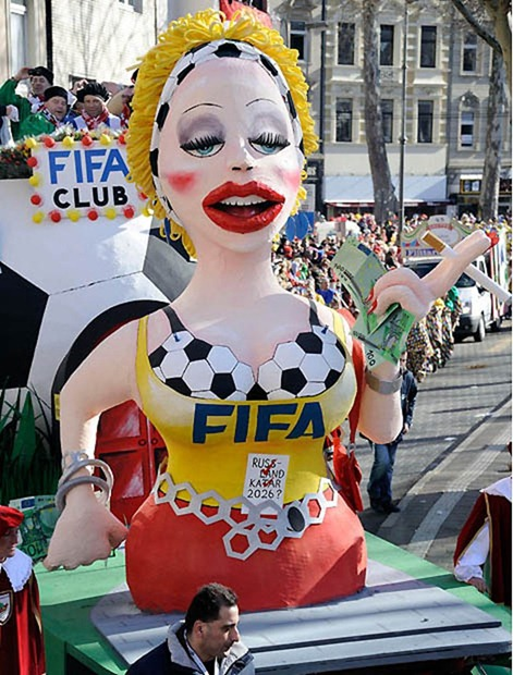 A carnival float shows the FIFA as a prostitute during the traditional Rosemonday carnival parade in Cologne, Germany, Monday, March 7, 2011.  The Rosemonday parade in Cologne, visited by one million spectators, is one of the highlights of the street carnival season. (AP Photo/Martin Meissner)