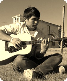 Playing in the field behind Dorm 2; Koko Relleve with acoustic guitar,  2007