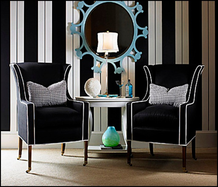 A modern take on a classic wing chair features upholstery in black woven acrylic boldly trimmed in white welting. The slender exposed wood legs have casters. Checkered houndstooth pillows extend the menswear theme and add punch. Here, black and white is dominant against a lively wall of stripes, where a sky-blue mirror stands out like a jewel. This chair from Century Furniture sells for $3,600. Photo from Century Furniture PRIMARY COLOR HG JAN08