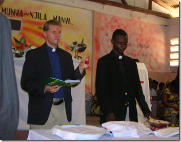 Bob and pastor Kabasele serve communion