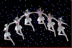 Performers are seen suspended above the stage during the closing ceremony of the the World Expo 2010 in Shanghai on October 31, 2010. Shanghai shuts the gates to the World Expo -- a six-month exhibition of culture and technology that saw record attendance, a parade of foreign leaders and a display of China's growing power.  AFP PHOTO/Philippe Lopez (Photo credit should read PHILIPPE LOPEZ/AFP/Getty Images)