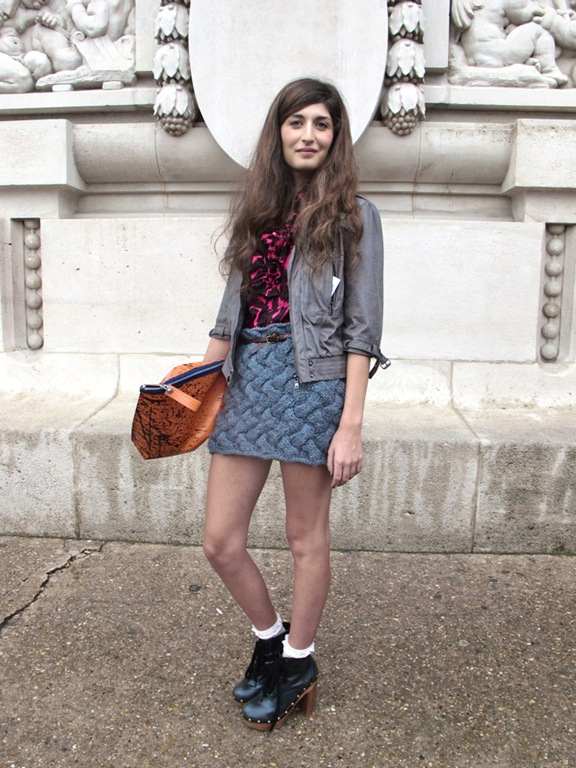 Facehunter image of a lady at Paris Fashion week wearing a woven knitted skirt.