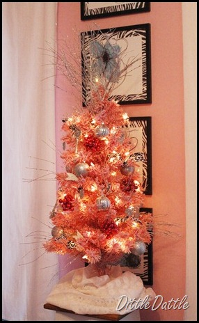 pink christmas tree with silver ornaments