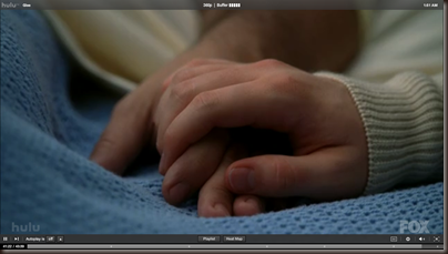 Kurt holding his dad's hand