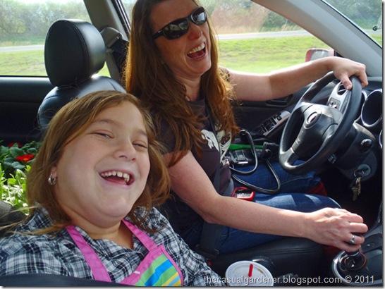 Shawna Coronado and kiddo laughing on road trip to Carolees Herb Farm.